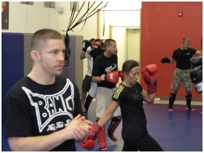 Muay Thai World Champion & founder of BANG Muay Thai, Duane Ludwig teaching a class at Fargo Muy Thai