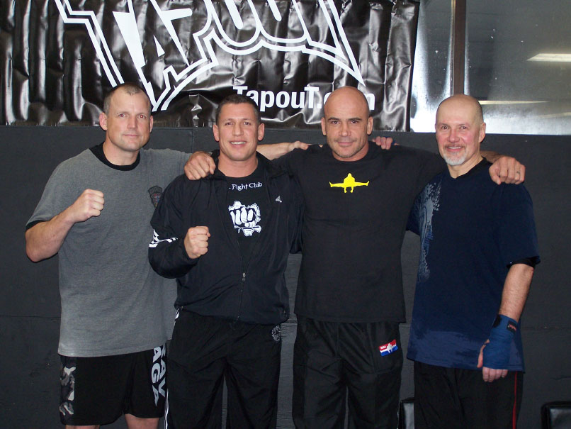 Lynn Schoenfeld, Sam Sade, Bas Rutten, Mark Blake standing together.